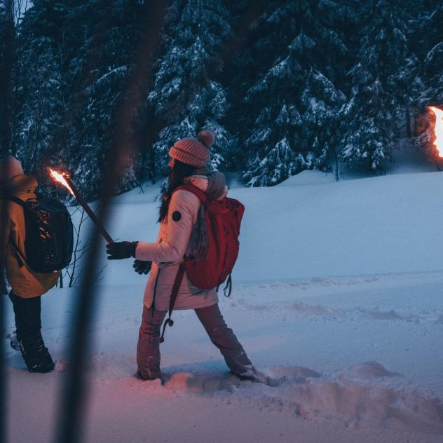Torchlight snowshoe walk