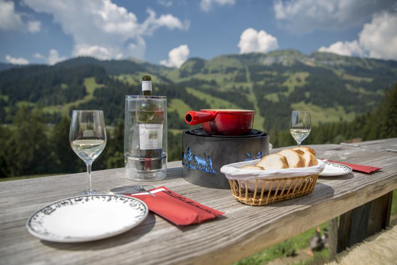 Eat a fondue in an alpine pasture